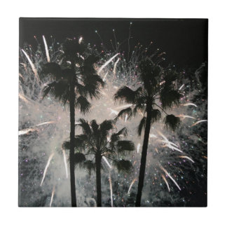 Fireworks behind palm  trees small square tile