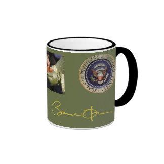 Firma de Obama y taza de la foto