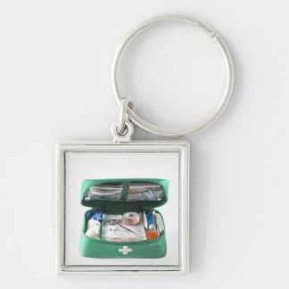 First aid kit. Silver-Colored square keychain