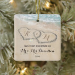 """First Christmas Mr & Mrs Tropical Hearts Ceramic Ornament<br><div class=""""desc"""">Stunning tropical beach themed christmas ornament featuring the ocean,  a sandy shoreline with two hearts,  your initials,  and a mr & mrs template that is easy to personalize.</div>"""