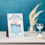 "First Easter Baby Boy Plaque With Easel 5&quot;x7&quot;<br><div class=""desc"">This adorable First Easter Baby Boy Plaque With Easel 5&quot;x7&quot; features a pastel colored squares background, a cute cartoon baby boy in a colorfully decorated cracked blue Easter egg. Two pastel colored Easter eggs next to him. Colorful pastel stylized text is First Easter. There is room set up for your...</div>"