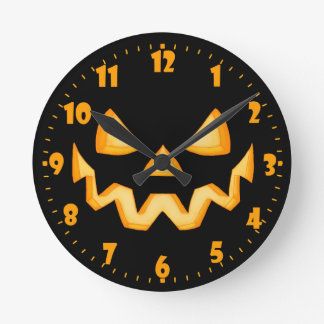 First Jack O Lantern In The Dark With An Evil Grin Round Clock