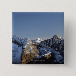 First snow on the mountains pinback button