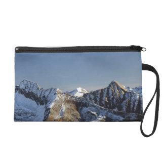 First snow on the mountains wristlet purse