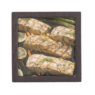 Fish and asparagus cooking on grill jewelry box