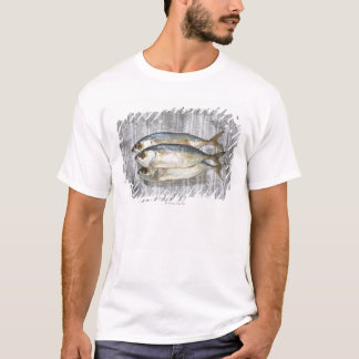 Fish on financial newspaper, elevated view T-Shirt