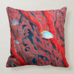 Fish swimming in coral throw pillow
