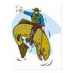 fisherman riding trout postcard