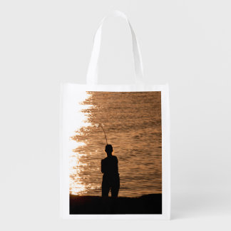 Fishing at sunset reusable grocery bag