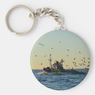 Fishing boat and a flock of gulls. key chain