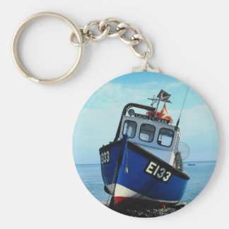 Fishing boat beached at pier keychain