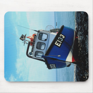Fishing boat beached at pier mouse pad