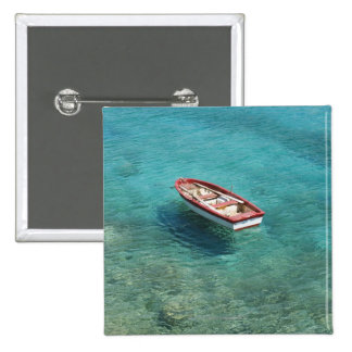 Fishing boat in clear, colorful water, Mani Pinback Button