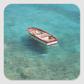 Fishing boat in clear, colorful water, Mani Square Sticker