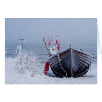 Fishing boat on shore of the Baltic Sea in winter Card