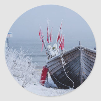 Fishing boat on shore of the Baltic Sea in winter Classic Round Sticker