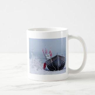 Fishing boat on shore of the Baltic Sea in winter Coffee Mug