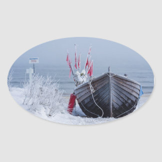 Fishing boat on shore of the Baltic Sea in winter Oval Sticker
