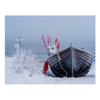 Fishing boat on shore of the Baltic Sea in winter Postcard