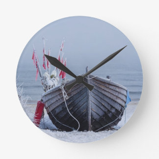 Fishing boat on shore of the Baltic Sea in winter Round Clock