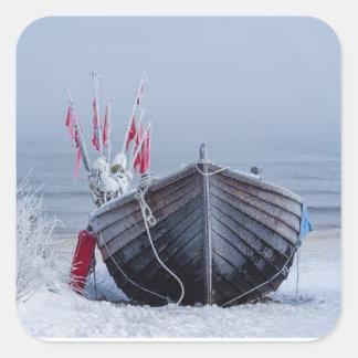 Fishing boat on shore of the Baltic Sea in winter Square Sticker