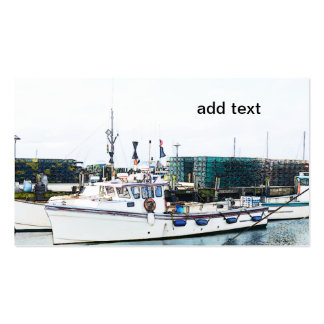 fishing boats docked in a harbor business card