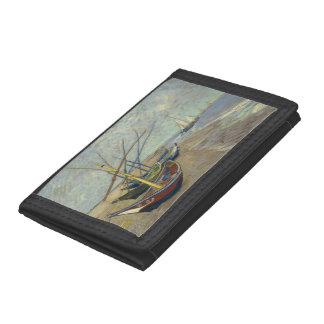 Fishing boats on the beach tri-fold wallets