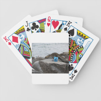 Fishing gear on the rock by the sea bicycle playing cards