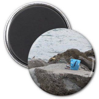 Fishing gear on the rock by the sea magnet
