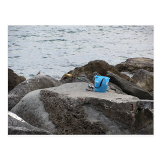 Fishing gear on the rock by the sea postcard