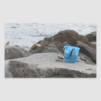 Fishing gear on the rock by the sea rectangular sticker