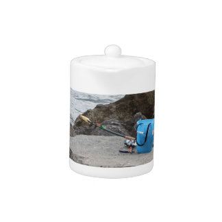 Fishing gear on the rock by the sea teapot