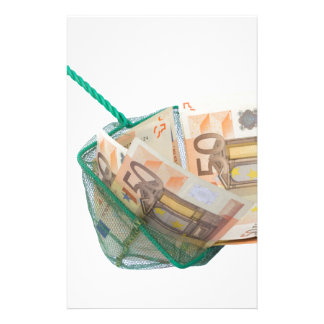 Fishing net filled with euro notes stationery
