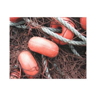 Fishing nets, floats and rope on the harbor canvas print