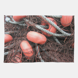 Fishing nets, floats and rope on the harbor hand towel
