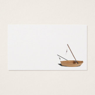 Fishing pole sitting in wooden boat business card