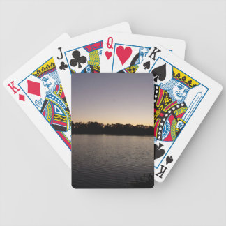 Fishing poles silhouette against the sun set bicycle playing cards