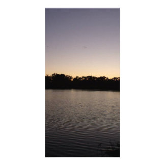 Fishing poles silhouette against the sun set card