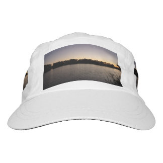 Fishing poles silhouette against the sun set headsweats hat