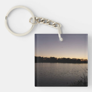 Fishing poles silhouette against the sun set keychain