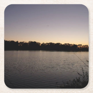 Fishing poles silhouette against the sun set square paper coaster