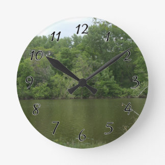 Fishing Post resting in front of a Lake Lanscape Wallclock