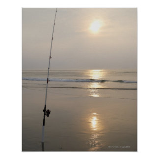 Fishing rod by the ocean in the early morning. poster