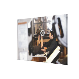 fitness coach works with 'senior' in gym canvas print