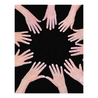 Five children hands joining in circle above black letterhead