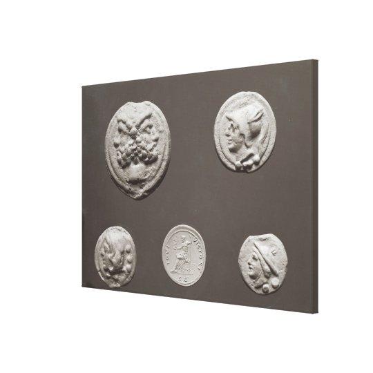 Five coins canvas print
