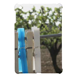 Five color clothespins hanging on rural background iPad mini cover