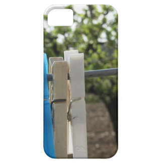 Five color clothespins hanging on rural background iPhone SE/5/5s case