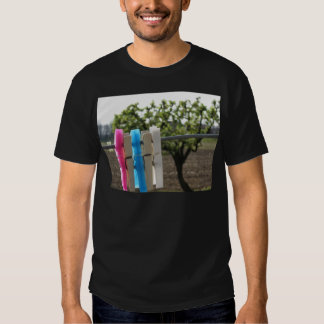 Five color clothespins hanging on rural background t-shirt