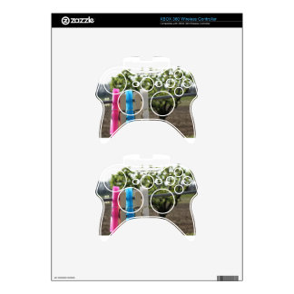 Five color clothespins hanging on rural background xbox 360 controller decal